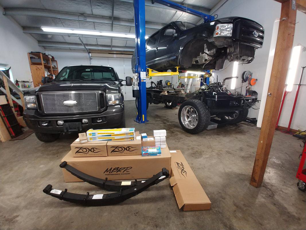 Two Black Ford Trucks