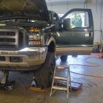 Hoisted Ford Truck in Shop