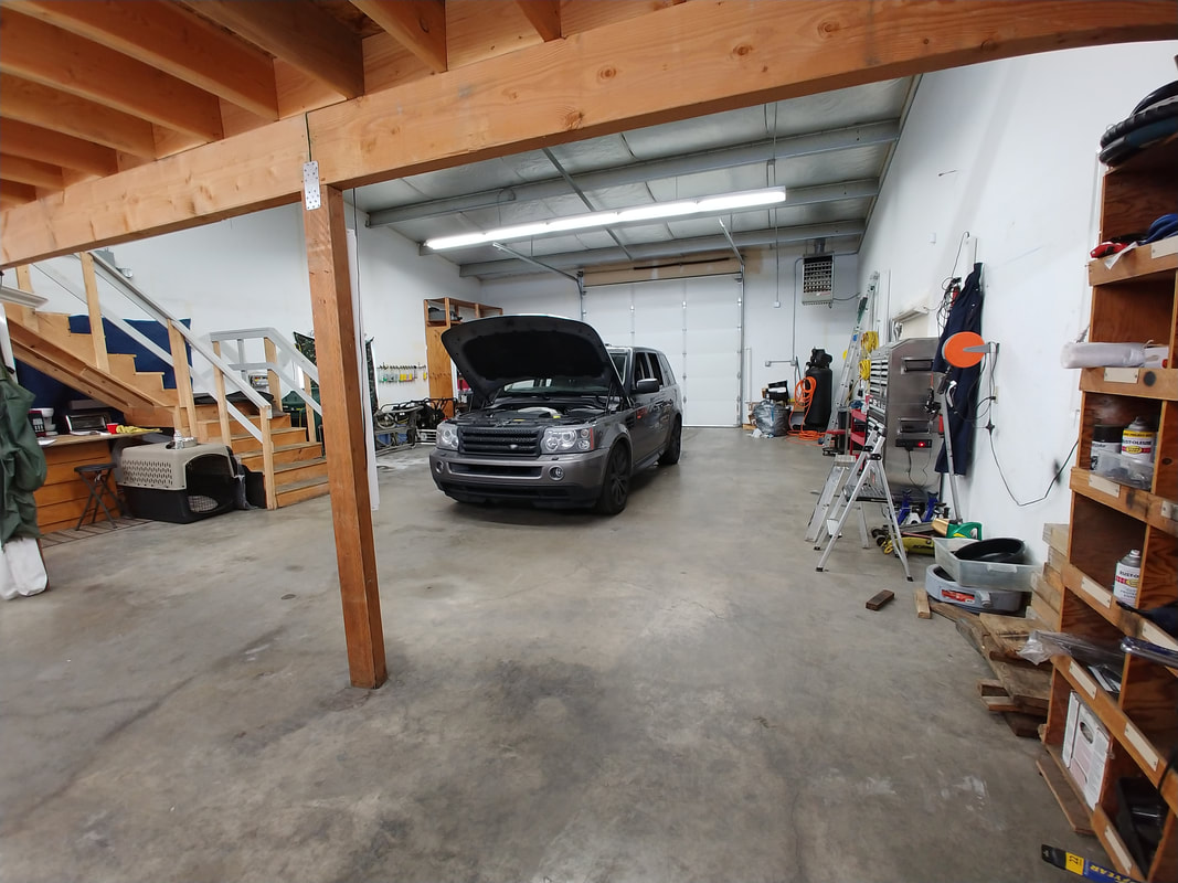 SUV / Hood Up in Shop