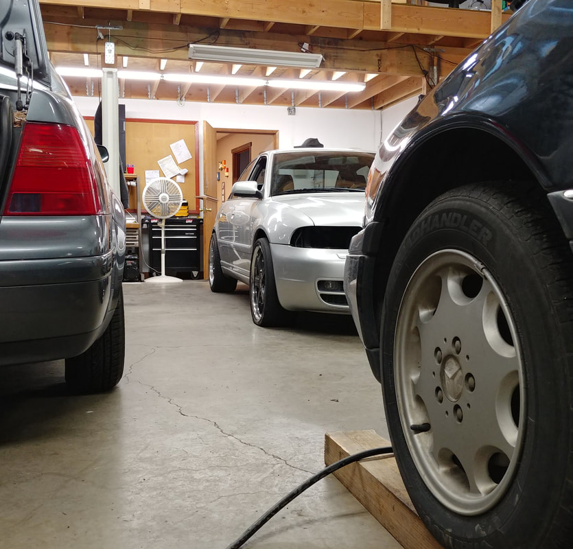 Three Vehicles in Shop