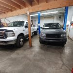 Large Truck and Small Vehicle in Shop