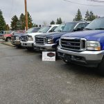 Line Up of Trucks & Business Card