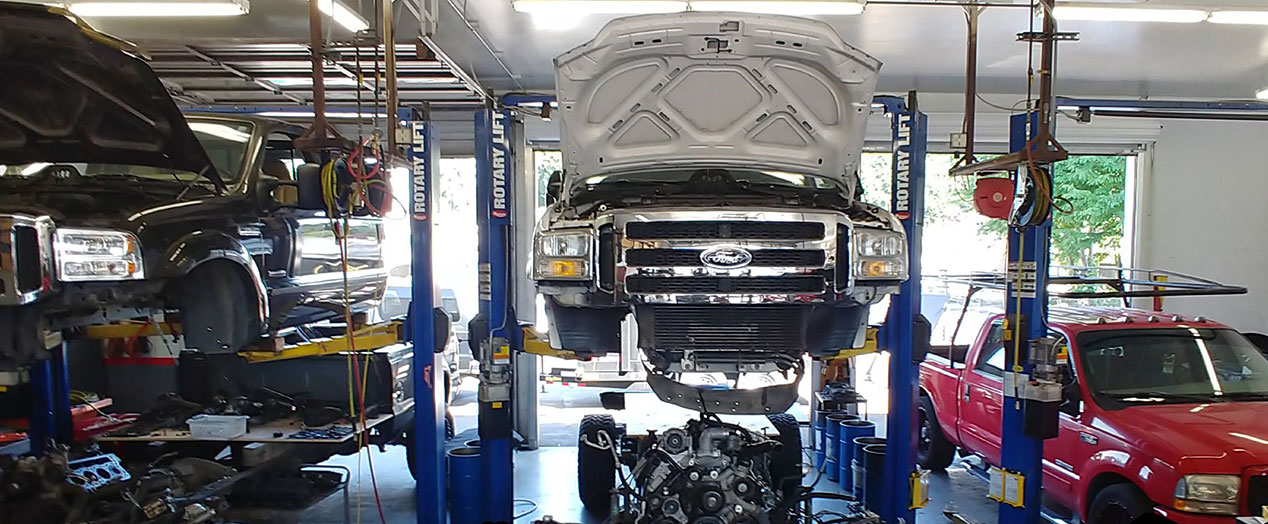 Hoisted Vehicles in Auto Body Shop